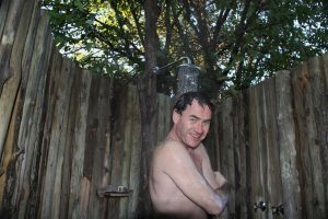 Aah, Rossy so loves being married to a photo-journalist ! Typical African outdoor shower.