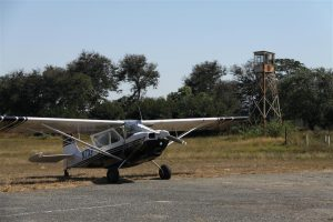 James' Citabria waits patiently at Kariba for everyone else to fuel up. That is a spare control tower.