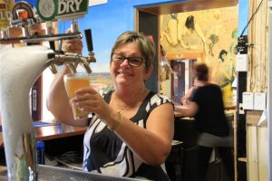 Publican Melissa Thomson at home at the taps.