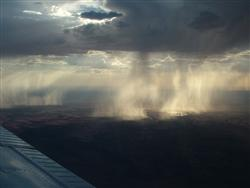 Simpson Desert early afternoon rain sizzles as it hits the parched earth