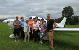 The Curtis Aviation fly-away team on the receiving end of a warm welcome at Frogs Hollow airfield.