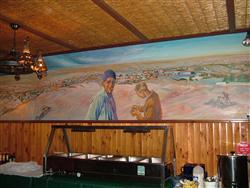 Wall murals of Andamooka's heydays adorn the pub's walls