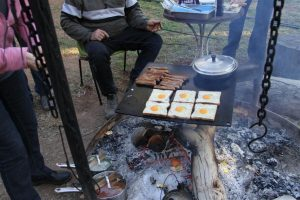 Who's hungry? Breakfast of champions over the campfire.