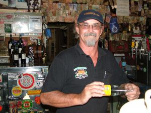 Daly Waters publican Lindsay Carmichael behind the taps.