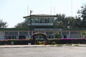 ATC Tower and bougainvillea-laden terminal at Kariba airport, Zimbabwe. Customs & immigration, here we go again