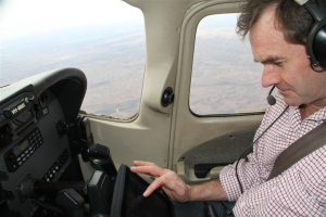 Rossy tunes in to the iPad at altitude to dispense with the last of his work emails.