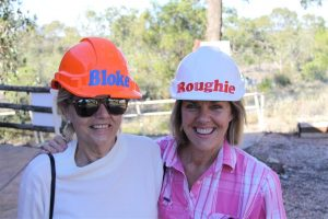 Sisters get into the swing of things as only die hard Lightning Ridge miners can.