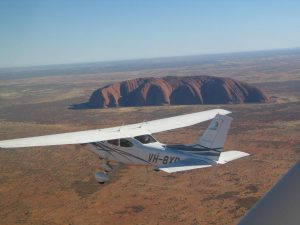 Curtis Aviation's Cessna 182, BXO, about to start the scenic pattern around Uluru & the Olgas.