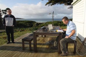 Not a bad place to call the office. Richard finds time for some flight planning on Three Hummock.