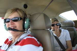 Julie Lockyer (front) and my sister Randi all smiles enroute as we leave behind the smog of Sydney.