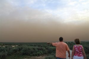 Wild dust storm over Mungo sent us scrambling to check the tie-downs on our planes. It left red dust inches thick over every surface