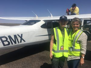 With Curtis Aviation pilot Christine Wright at Alice Springs
