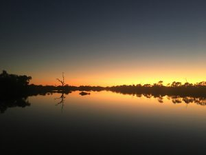 Hop up early for the sunrise over the billabong at the end of the main street.