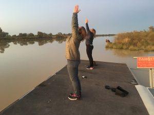 Take a pal and do some yoga on the pontoon. Dare ya.