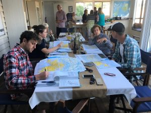 The big dining room in the beach house makes a fine flight planning desk for the crews.