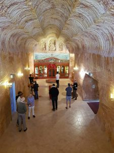 Join a tour or drive yourself to see some incredible examples of underground church architecture in the town.