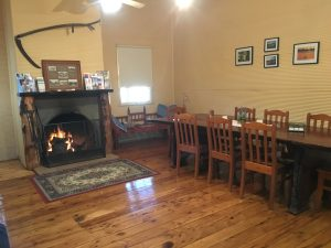 Your sleeping quarters come with this warm and welcoming dining room and cozy fireplace.